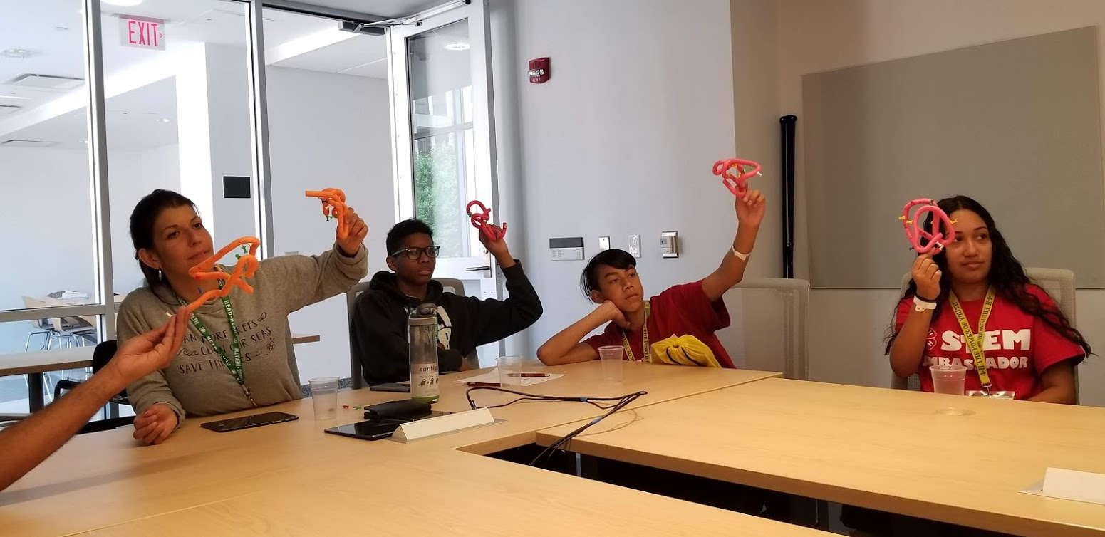 "Students learn how Proteins ""fold"" with a hands-on exercise led by Dr. Shuchi Dutta in the Proteomics building on Busch Campus."